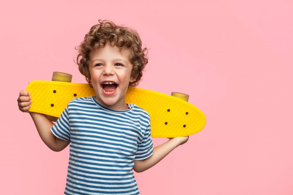 Laughing skateboard boy