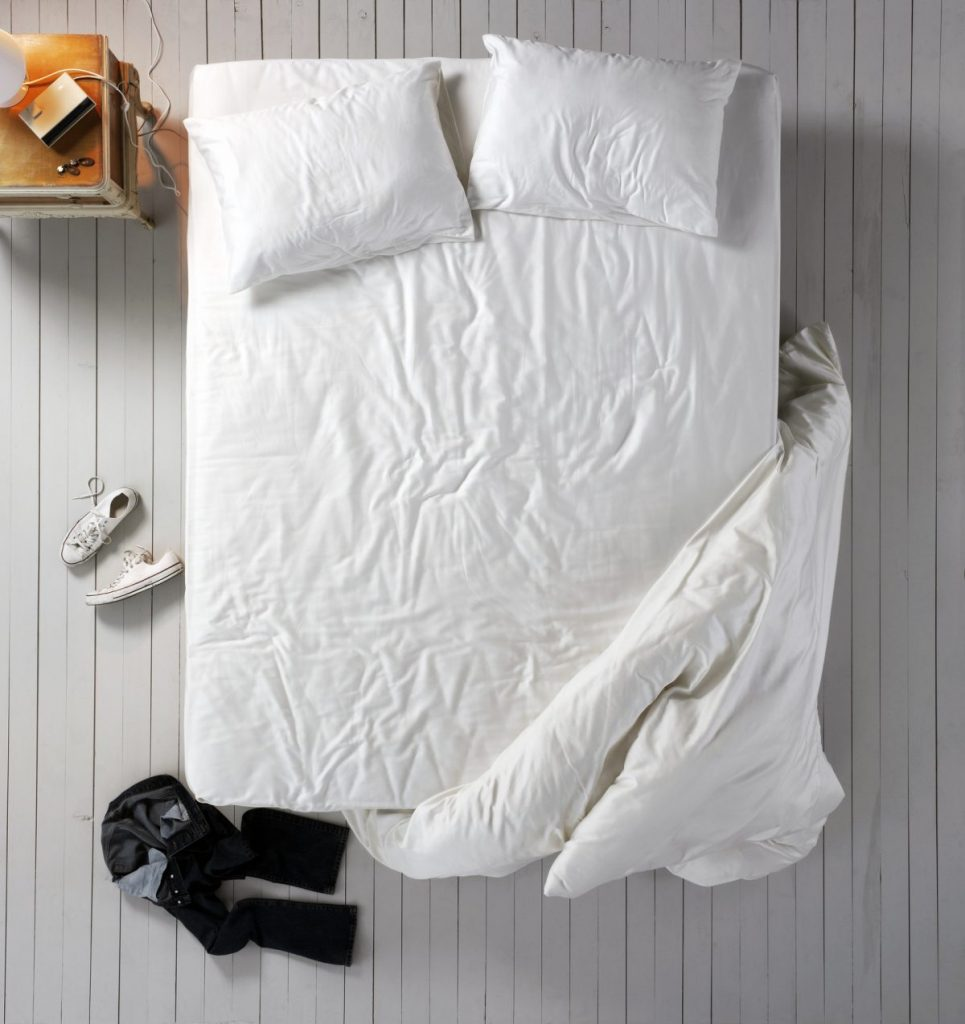 Bed with wrinkly sheet