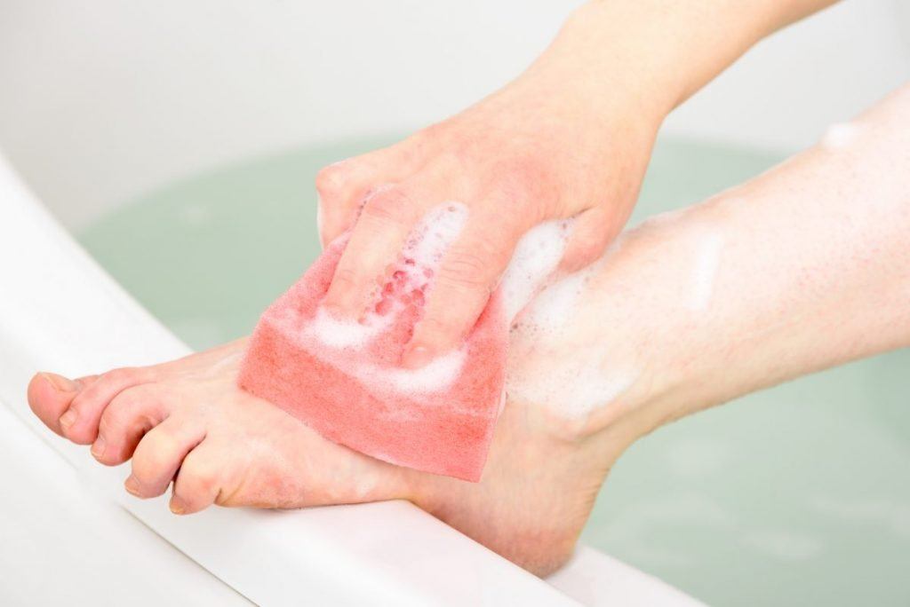 thoroughly cleaning foot