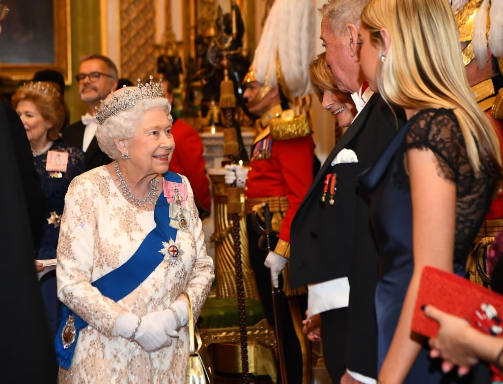 Queen Elizabeth II greets greets the family of the ambassador of Norway at an evening reception for members of the Diplomatic Corps at Buckingham Palace on December 04, 2018 in London, England. Approximately 7,500 military personnel are currently serving overseas at Christmas.