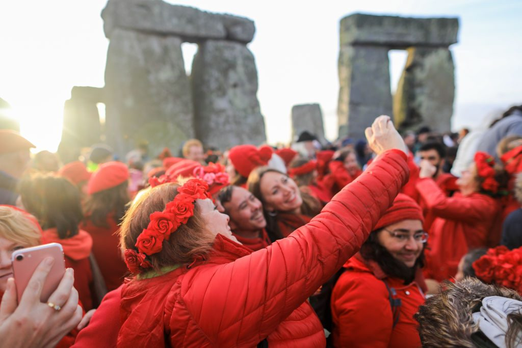 2: People take selfie photographs as druids, pagans and revellers gather at Stonehenge, hoping to see the sun rise, as they take part in a winter solstice ceremony at the ancient neolithic monument of Stonehenge near Amesbury on December 22, 2018 in Wiltshire, England. A large crowd gathered at the famous historic stone circle, a UNESCO listed ancient monument to celebrate the sunrise closest to the Winter Solstice, the shortest day of the year. The event is claimed to be more important in the pagan calendar than the summer solstice, because it marks the 're-birth' of the Sun for the New Year.