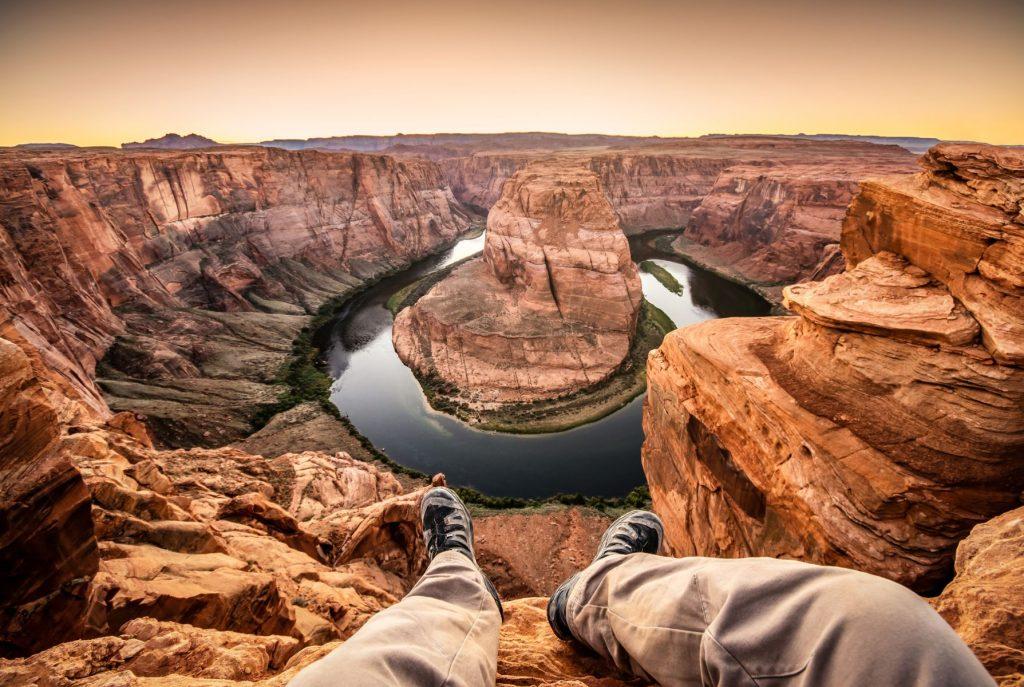 Man living on the edge at the horseshoe bend. Page, Arizona. USA