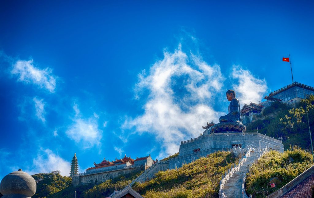 Big buddha statue at the top of Fansipan mountain, Sapa, Lao Cai, Vietnam. Spectacular Fansipan Legend