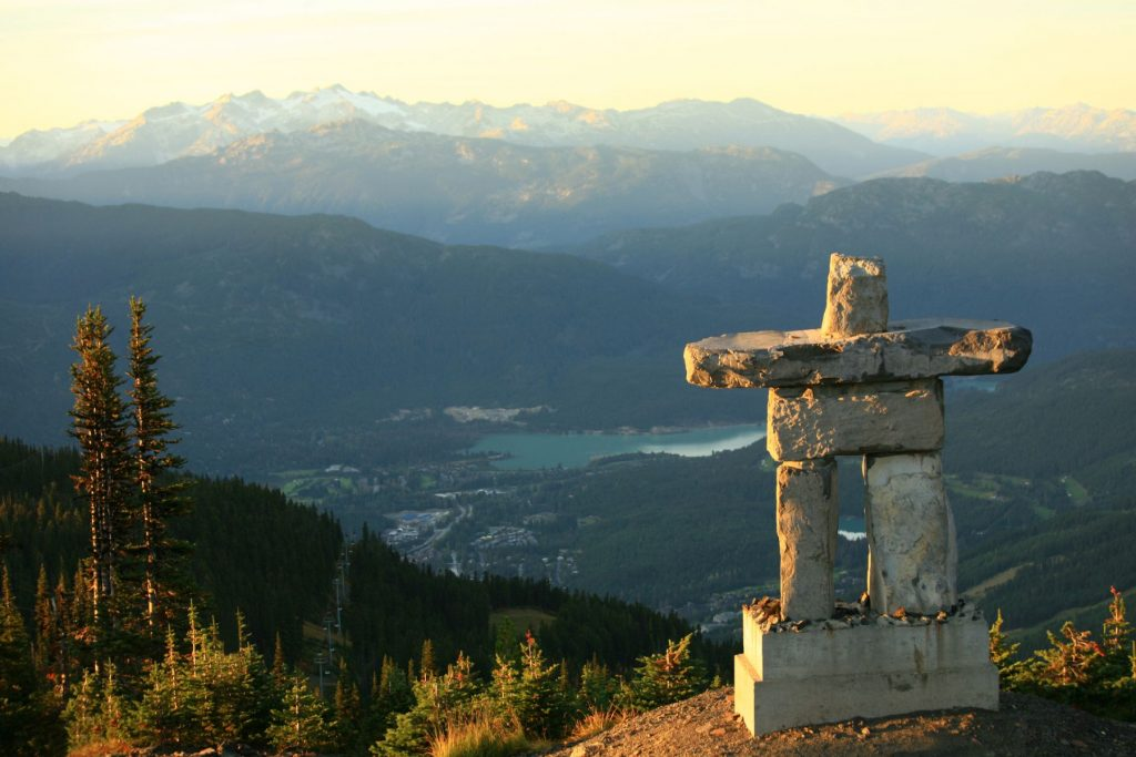 An inukshuk in Whistler, BC, Canada. This beautiful inukshuk - a rock statue that was symbolic for First Nations people - stands at the top of Whistler Mountain in the Whistler Blackcomb Resort in Whistler, British Columbia, Canada. The image was taken in summer.