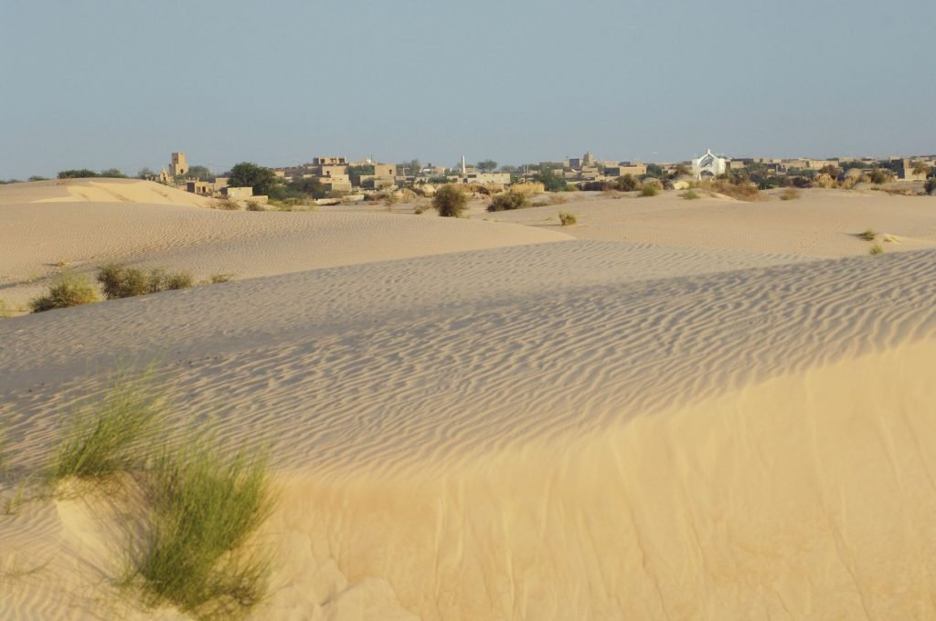 """Looking across the sand dunes of the Sahara Desert towards the legendary city of Timbuktu.Mali, West Africa"""