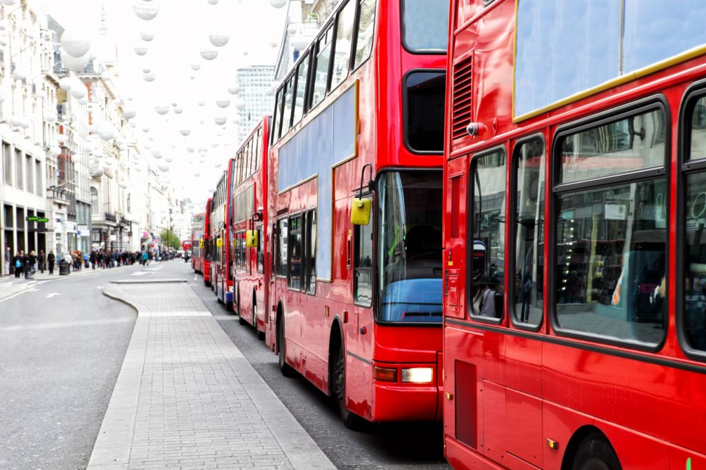 A long traffic jam consisting of only red London buses in Oxford Street, London's busiest shopping street