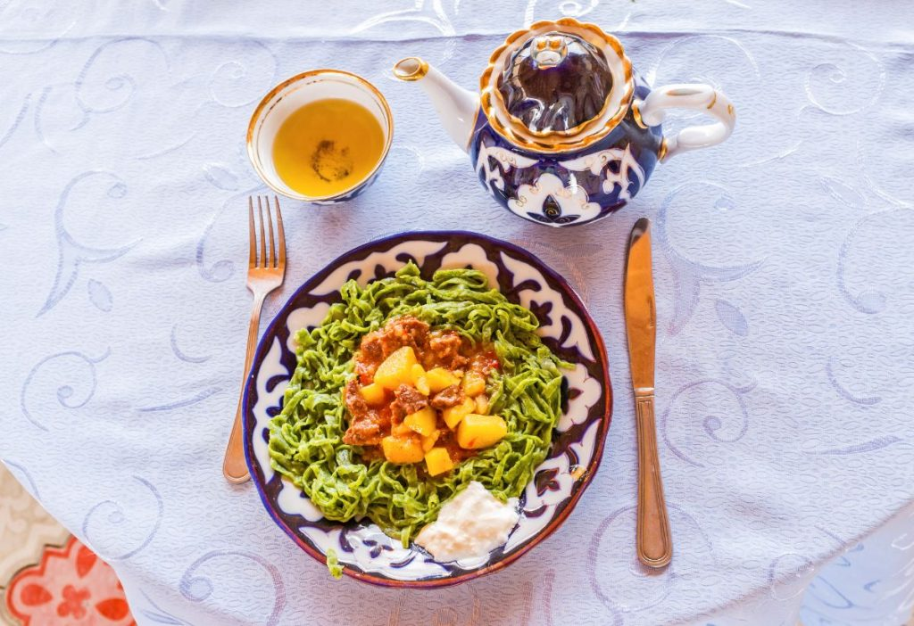 The famous dish of Khiva, named shuvit oshi is the green spaghetti with meat and vegetables, Uzbekistan.