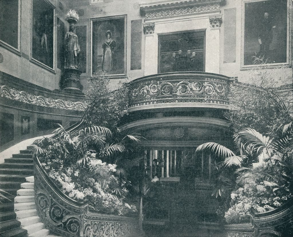 The Grand Staircase at Buckingham Palace', c1899, (1901). The Grand Staircase at Buckingham Palace, designed by the architect John Nash (1752-1835), at the request of King George IV (1762-1830). From V.R.I., Her Life and Empire, by The Marquis of Lorne, K.T. <span data-shortcode=