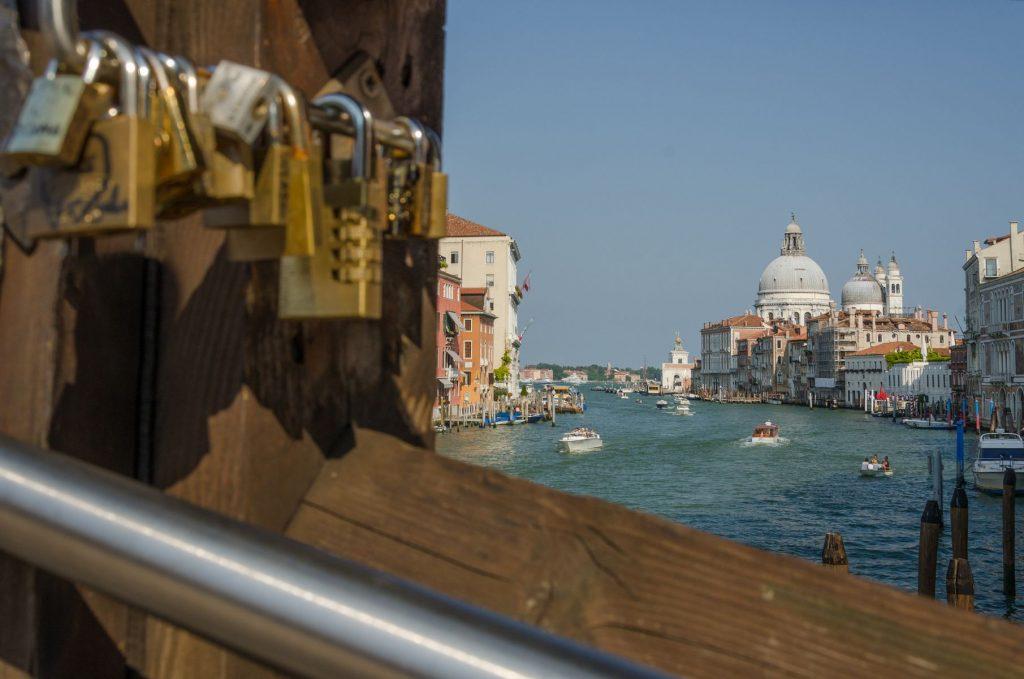 Church Santa Maria della Salute seen through the bridge with love locks, Ponte dell Accademia, Venice, and church Santa Maria della Salute