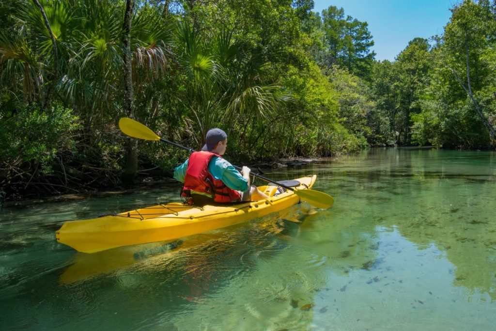A lone kayaker paddles the Weeki Wachee River in Florida.