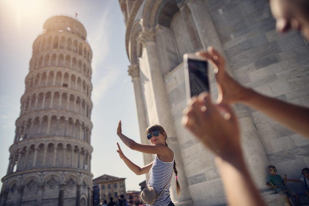 Family sightseeing Pisa, Italy.