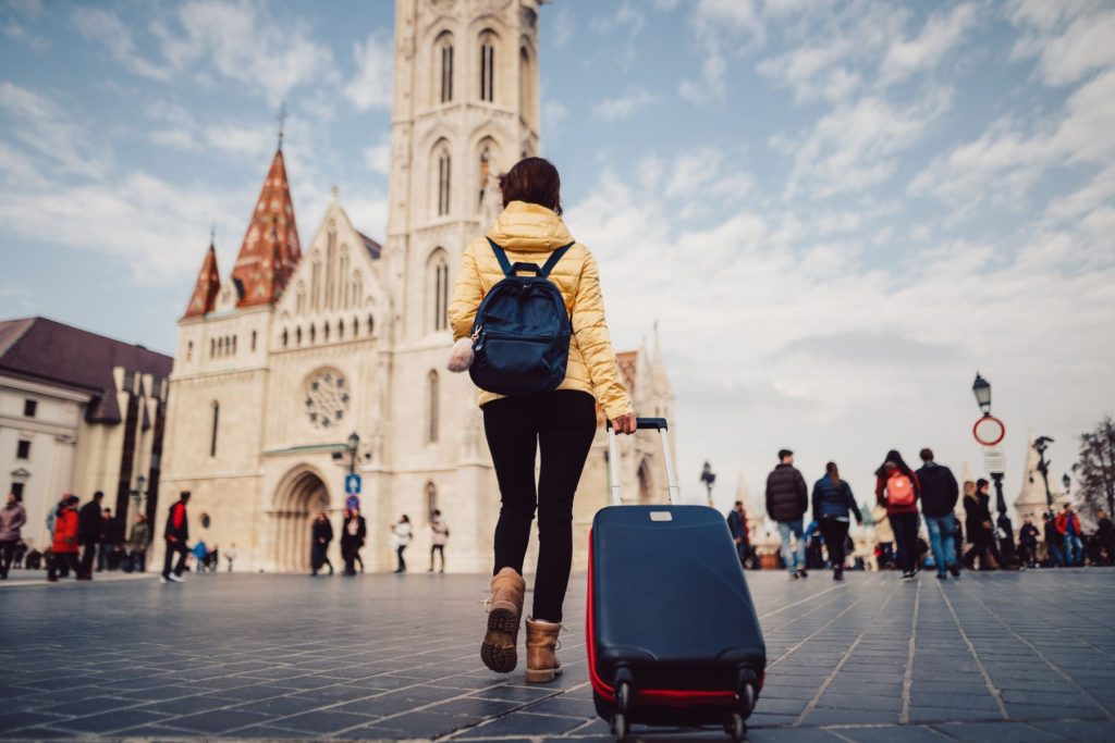 Young woman with suitcase at the castle hill-budapest