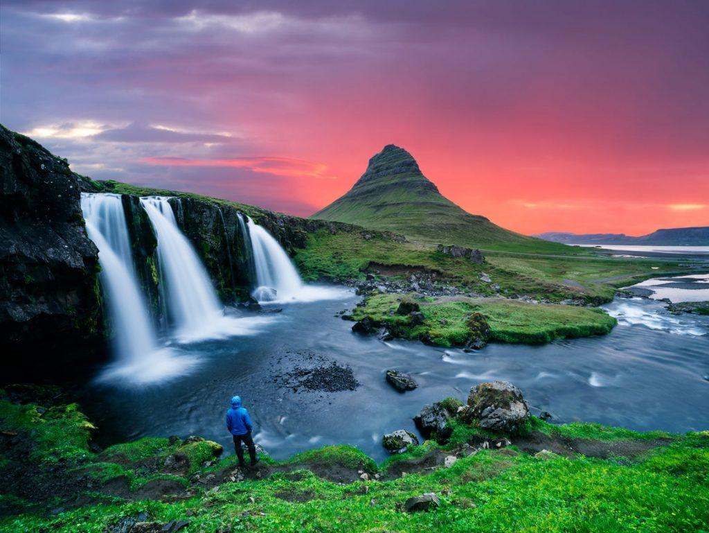 Kirkjufellsfoss waterfall and Kirkjufell mountain. A famous tourist attraction near the city of Grundarfjordur. Stunning Icelandic landscape.