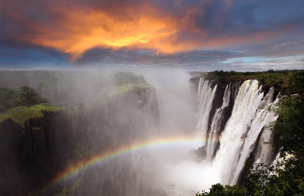 Victoria Falls sunset with rainbow, Zambia