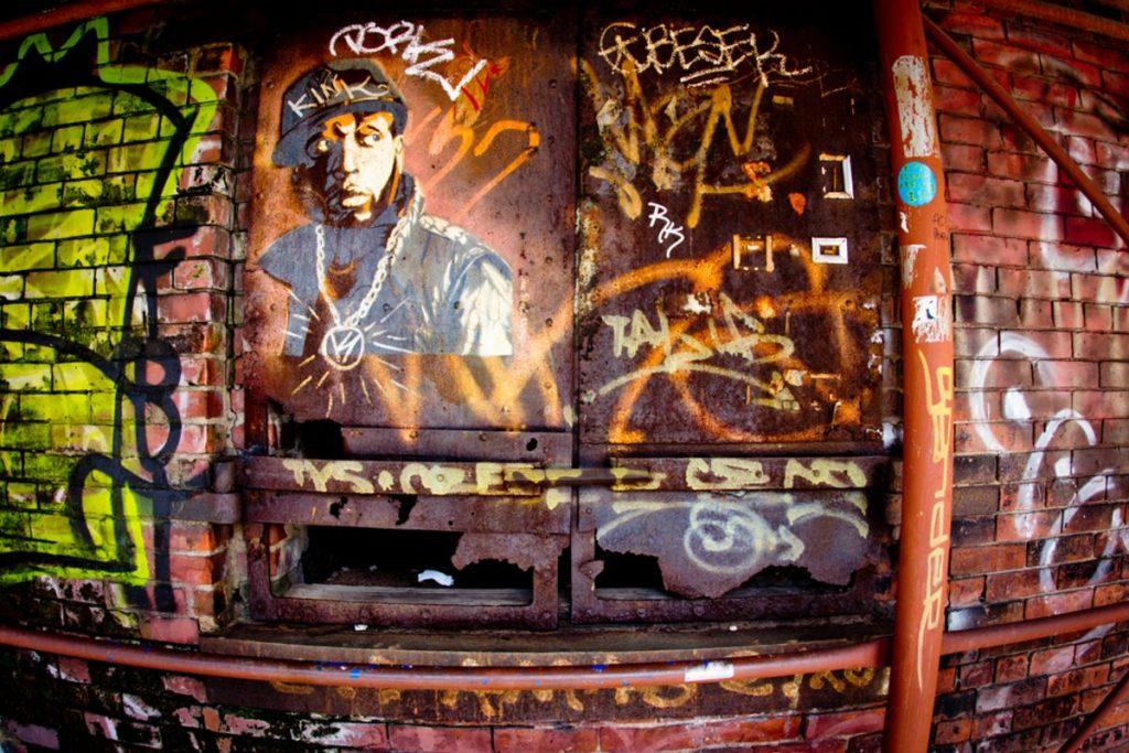 Example of urban street art on landmark Empire Store Building in DUMBO Brooklyn, NY