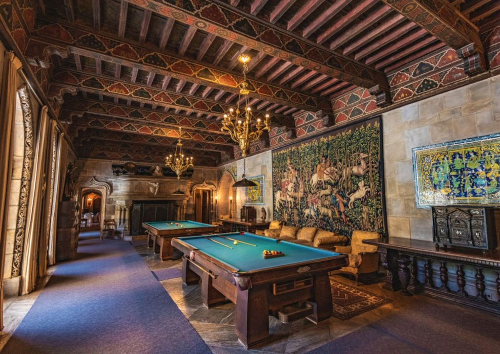 The Billiard Room was a popular spot for William Randolph Hearst to bring guests to relax and mingle. The room includes a spanish ceiling and tapestries.