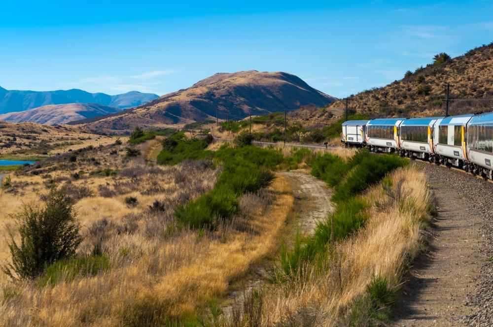 iwiRail TranzAlpine scenic train, riding among beautiful plains and mountains, popular tourist transportation on South Island