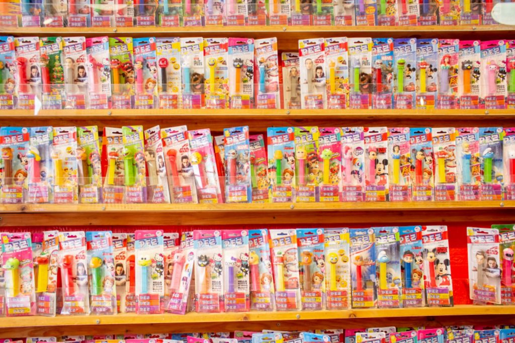 Shelves full of Pez candy dispensers featuring favorite fictional character heads