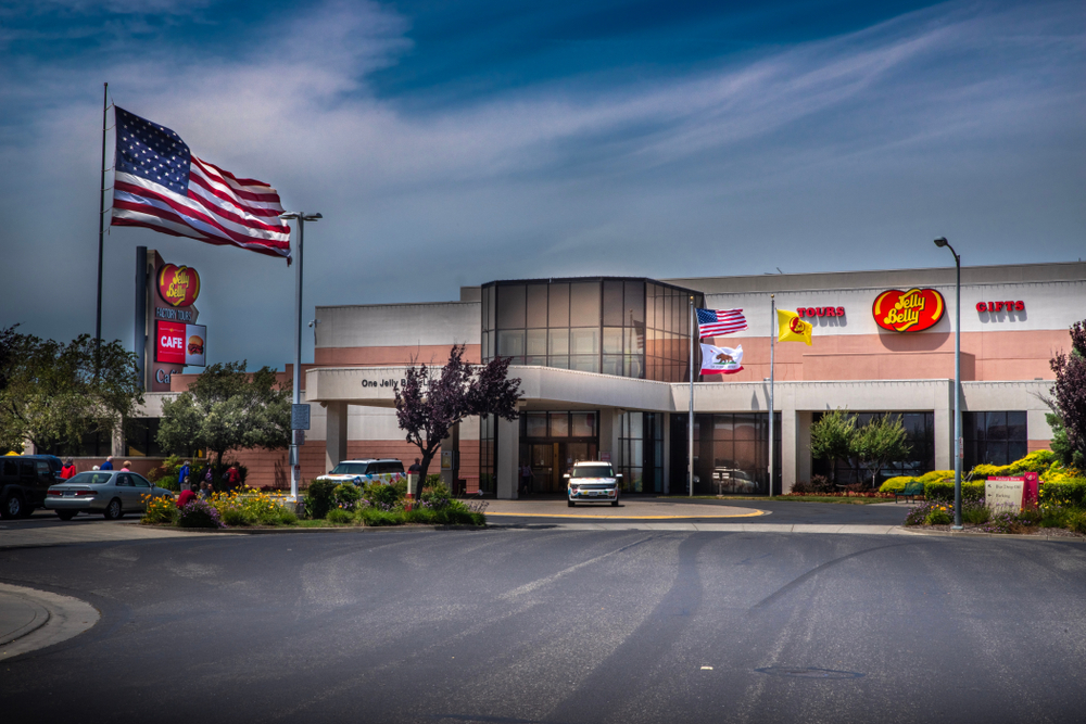 large American flag flies over the home and headquarters of Jelly Belly candy where people can tour the factory and corporate store