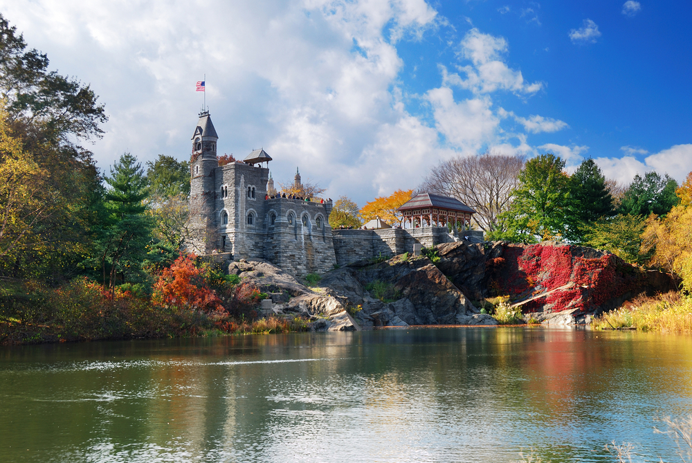 Manhattan Central Park in Autumn with Belvedere Castle and colorful trees over lake with reflection