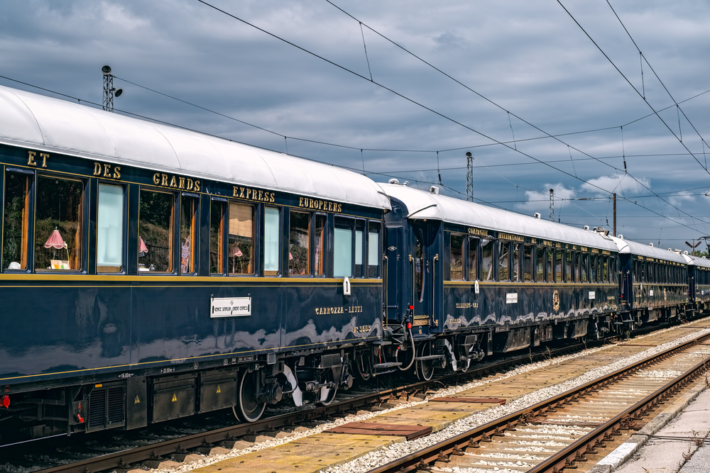 The legendary Venice Simplon Orient Express is ready to depart from Ruse Railway station in a cloudy day.