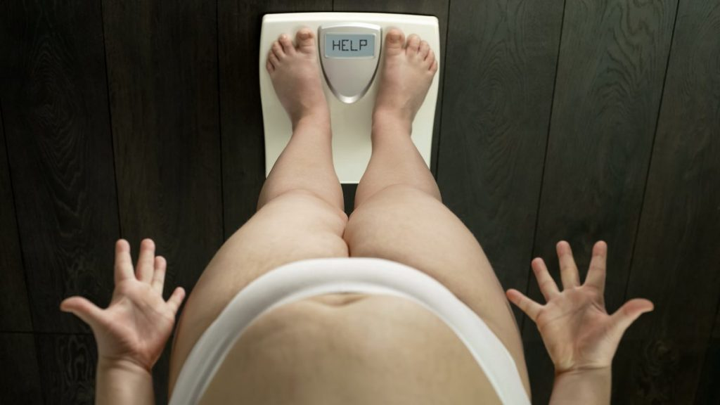obese girl desperate weight scale