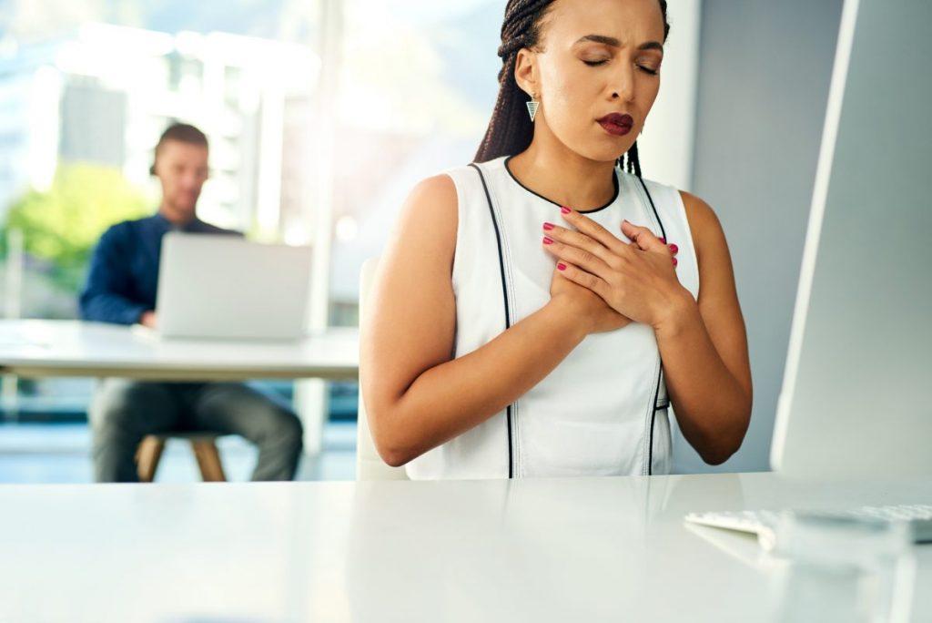 woman heartburn acid reflux