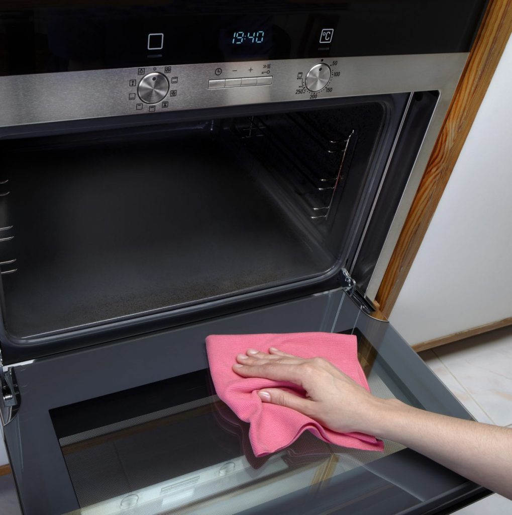 routine oven cleaning scrubbing