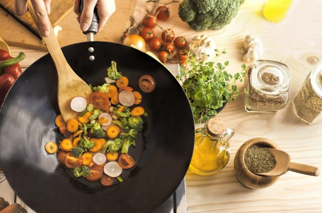 cooking veggies in wok
