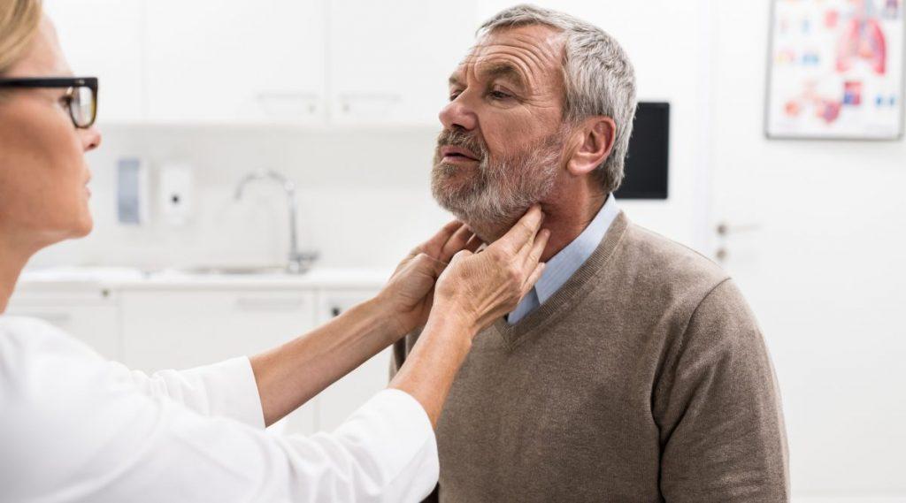 Doctor examining patient's lymph nodes