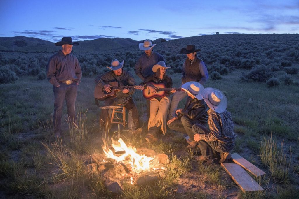 Cowboys gathering around campfire