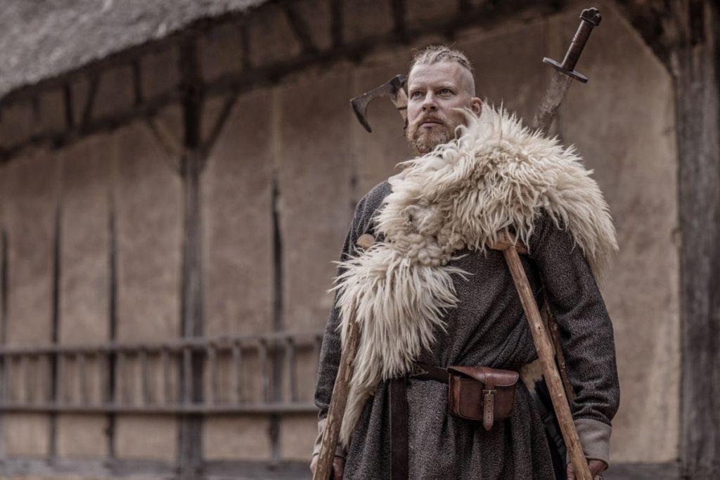 Caucasian Bearded Viking Warrior Chief Male near farmhouse surroundings