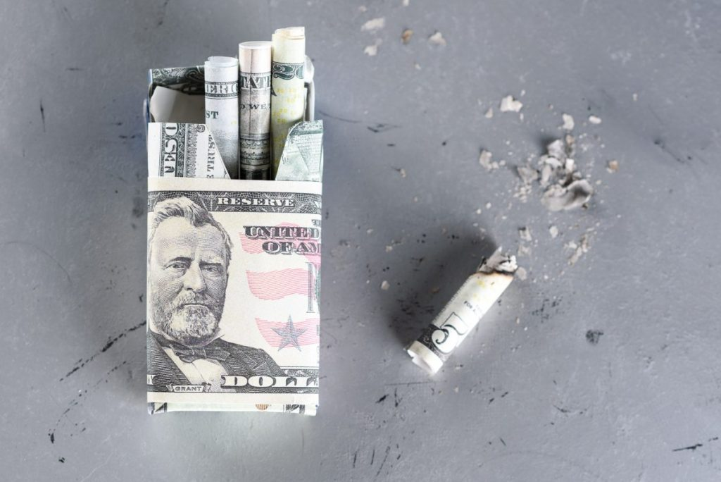 money folded into cigarette shape
