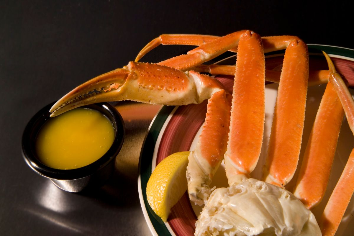 Close up of crab legs with melted butter