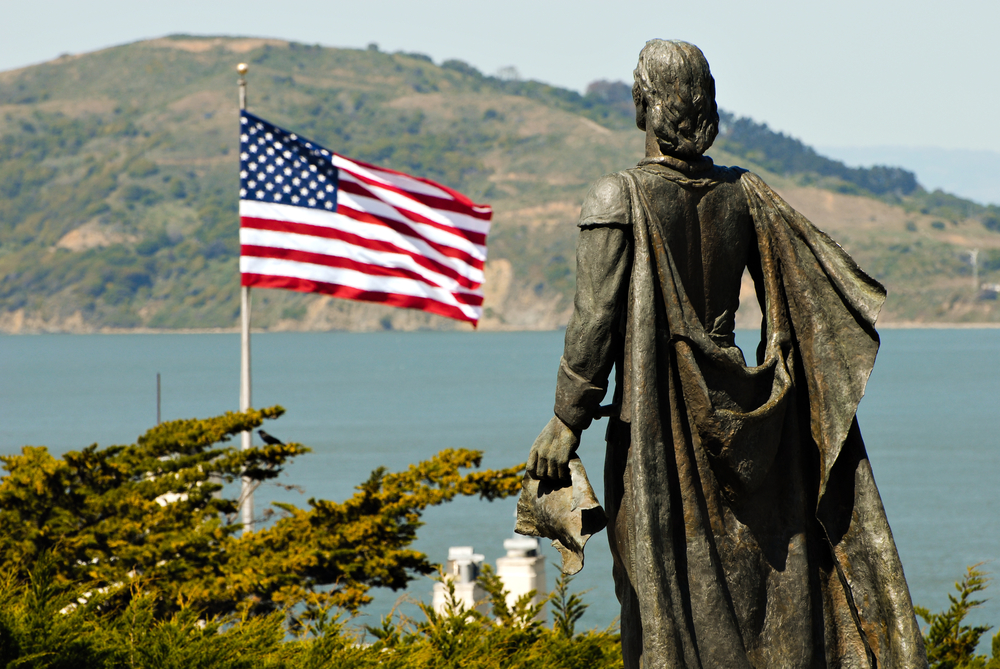 Statue of Christopher Columbus and USA flag in San Francisco