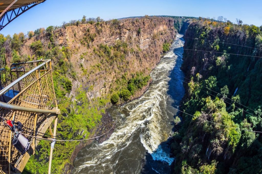 The famous Victoria Falls in Zambia. Bungee jumping from a bridge near waterfall