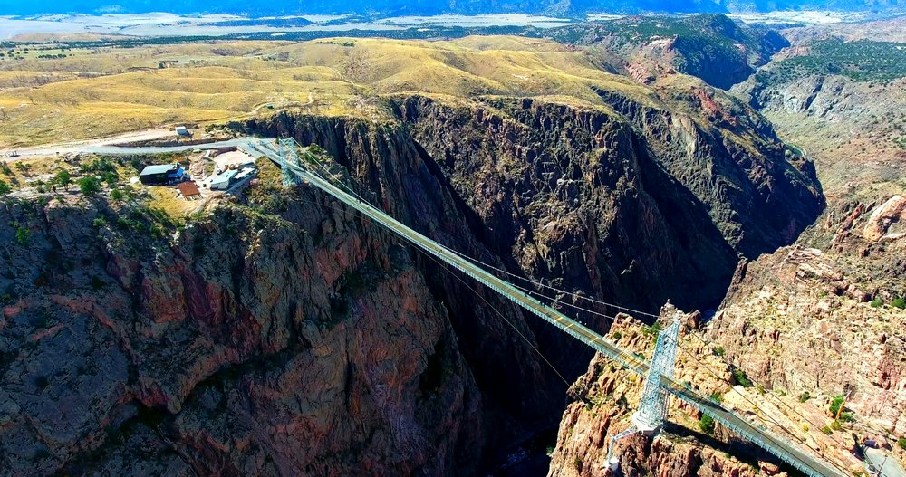 Suspension Bridge Over Deep Canyon - Wide Aerial View Of Royal Gorge Bridge In Colorado, USA