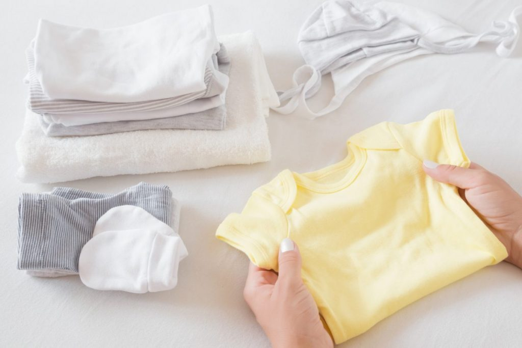 woman sorting baby clothes