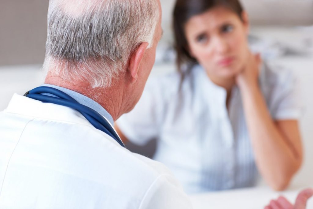 doctor patient uncomfortable lying