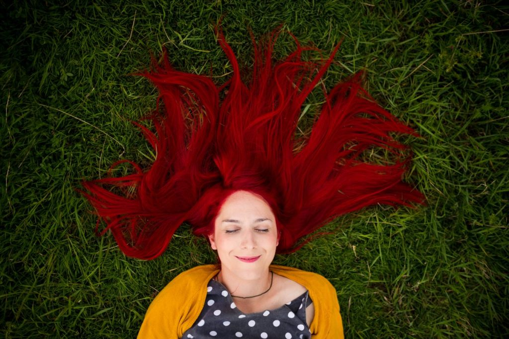 Red-haired woman in the grass