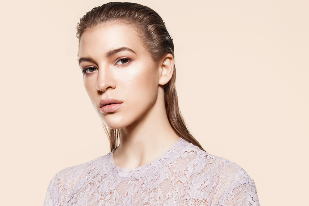 Portrait of a stylish woman model with natural make-up and wet hair