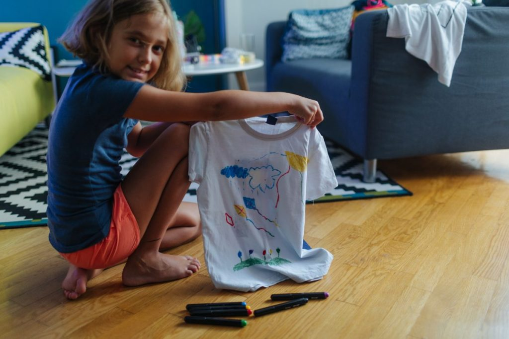 girl drawing on t-shirt