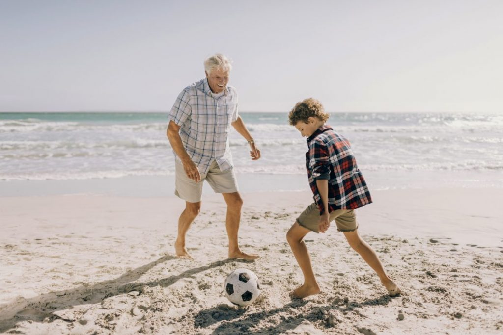 grandfather young boy beach ball