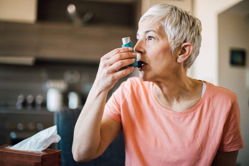 woman with an asthma inhaler