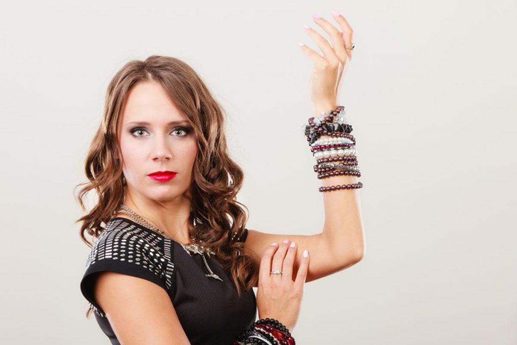 Woman wearing several bracelets