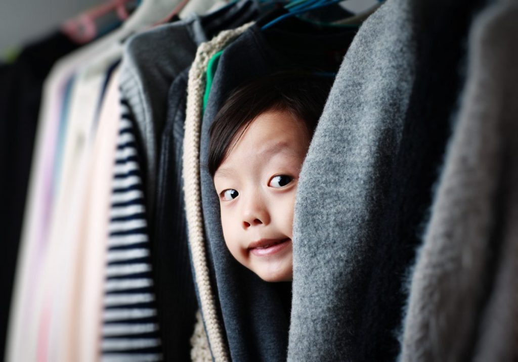 child hiding in closet