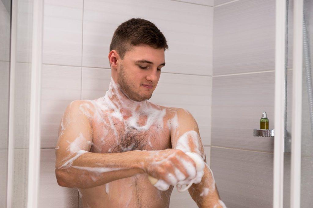 man bathing soap