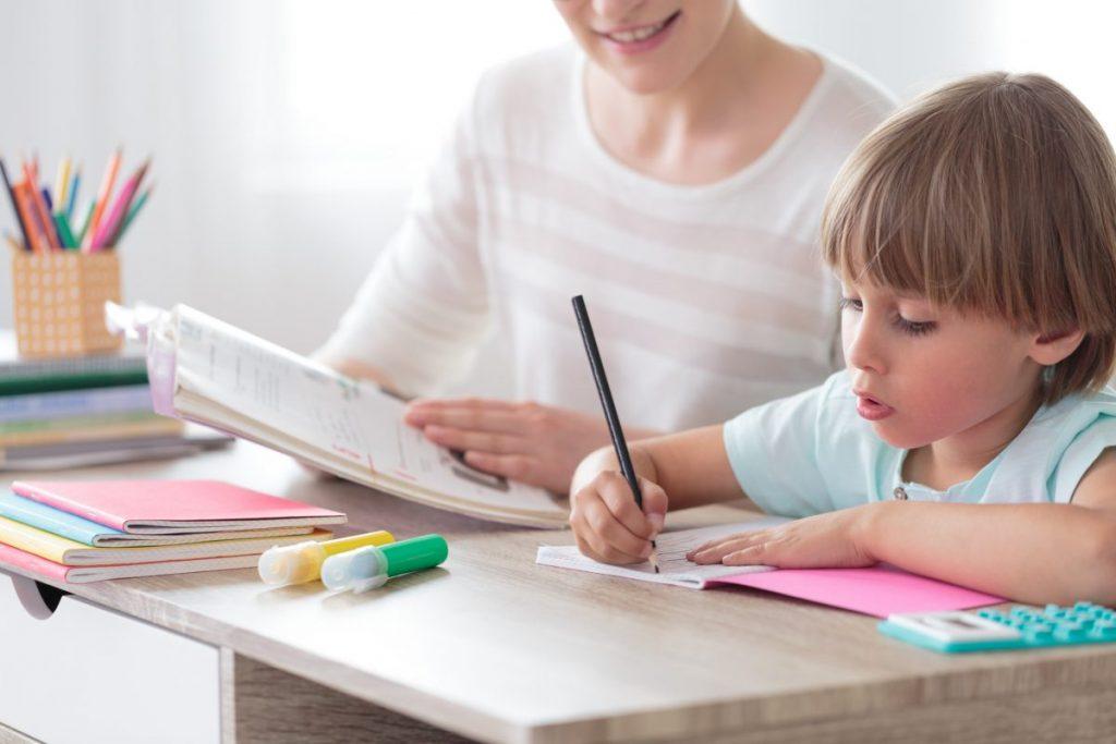 child focusing homework