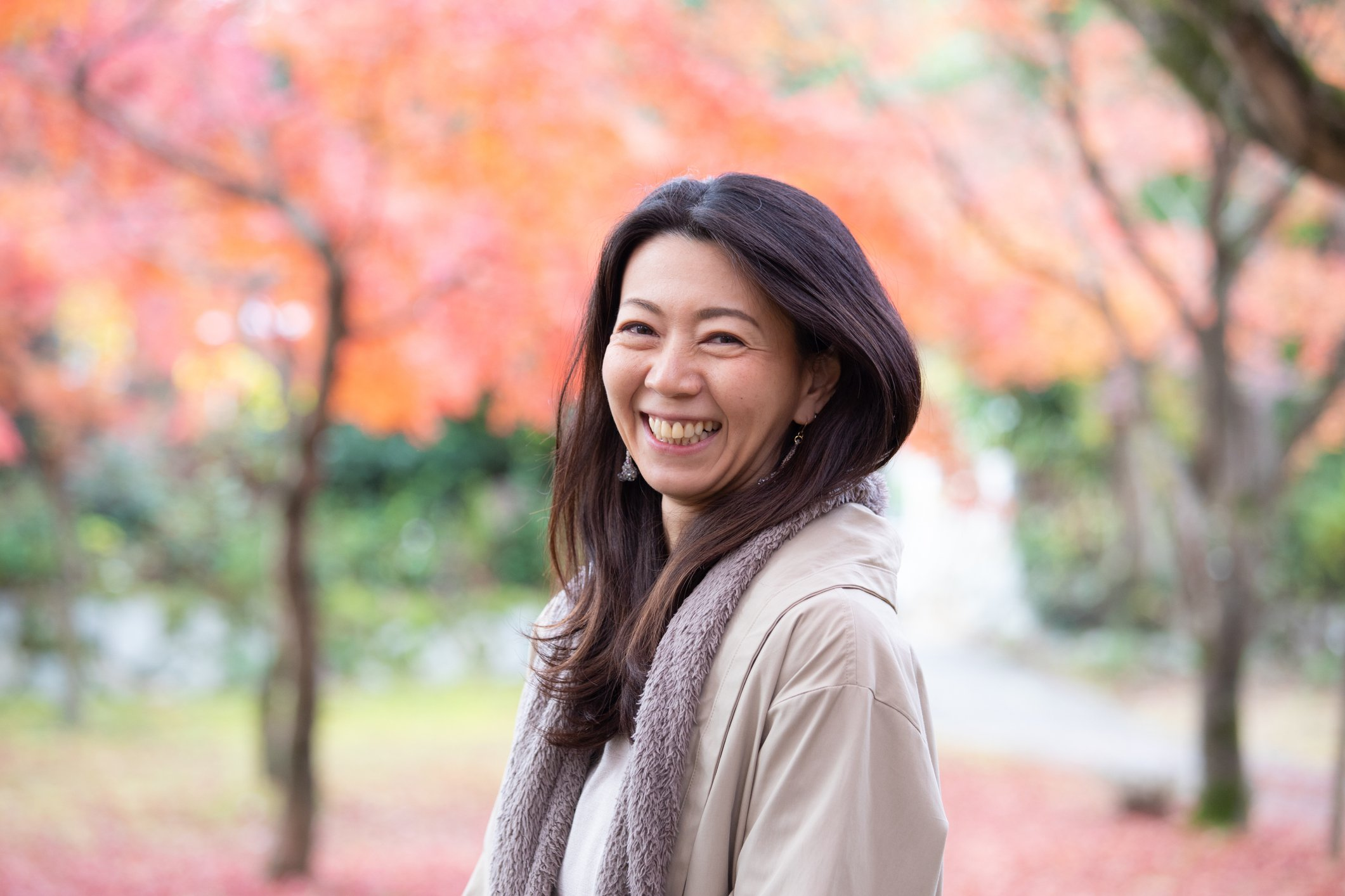 Beautiful Japanese woman enjoying autumn