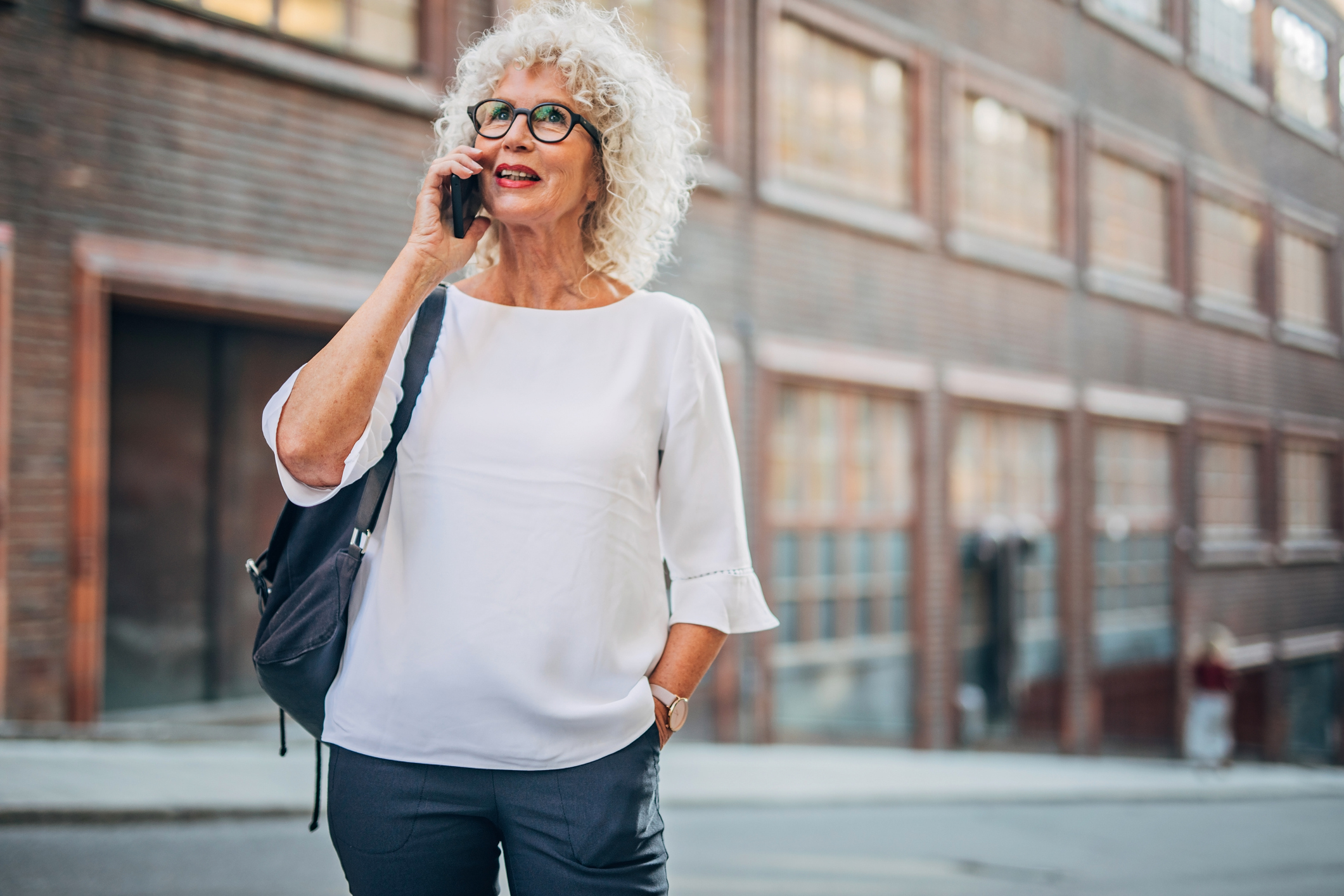 Lady talking on mobile on the street